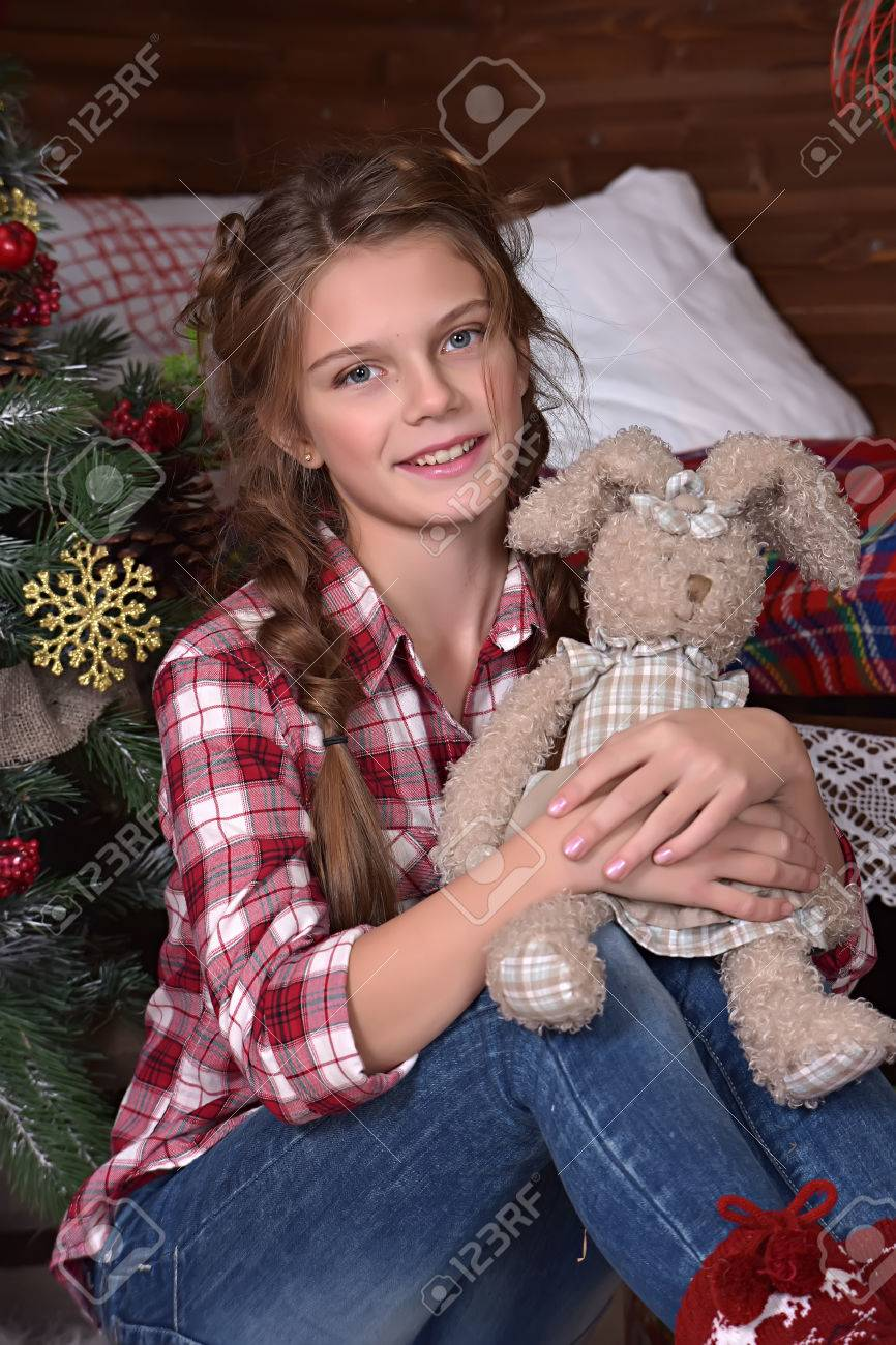 Stock Photo Teen Girl In A Plaid Shirt With A Toy Hare