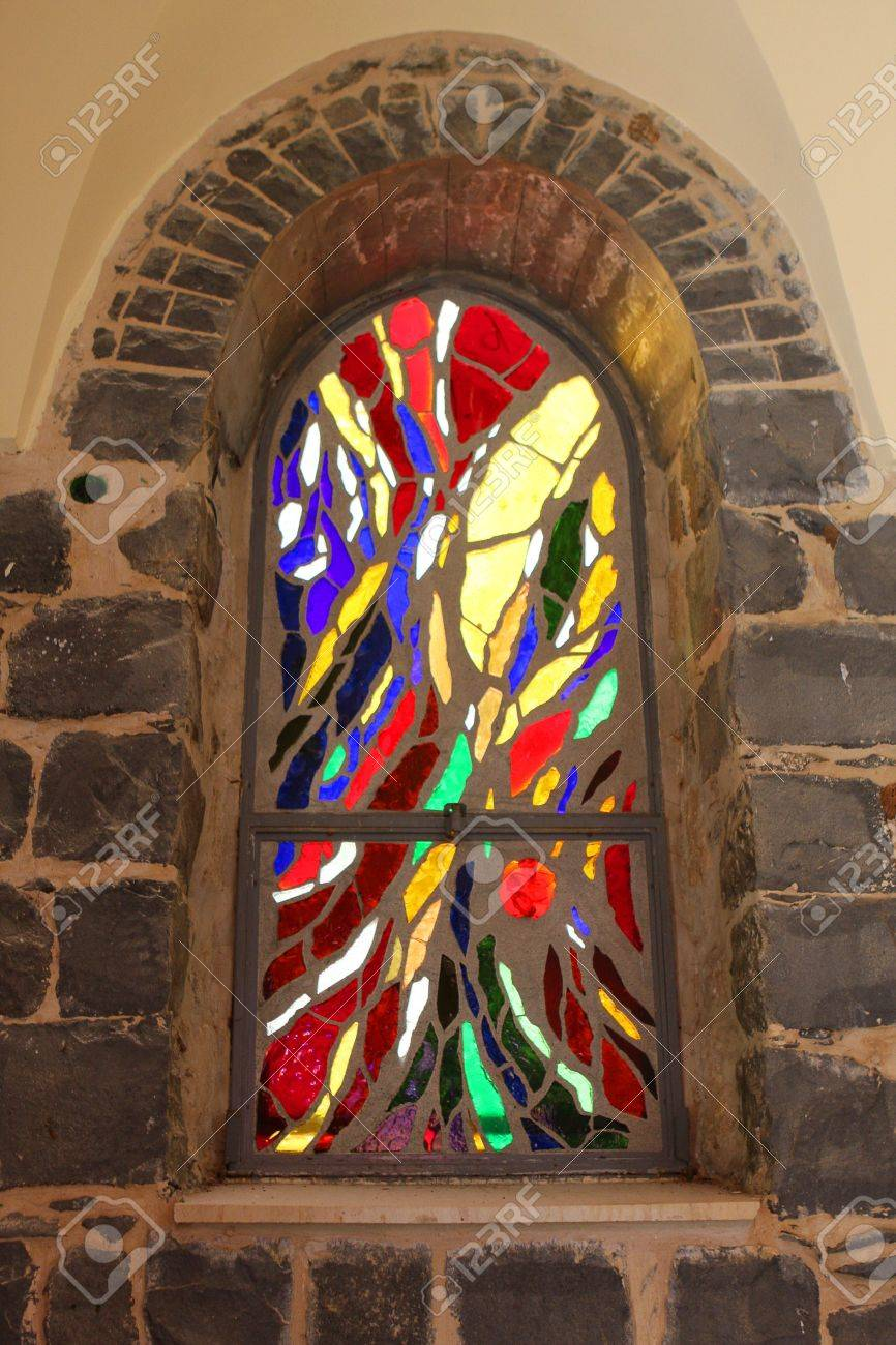 Window in catholic church, made of stained glass Stock Photo - 8688671