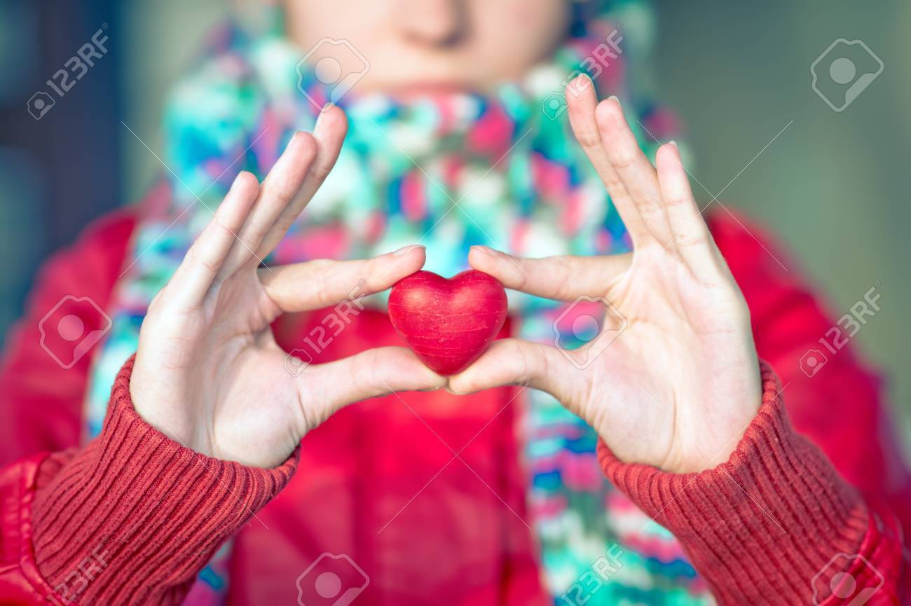Heart Shape Love Symbol In Woman Hands With Face On Background ...