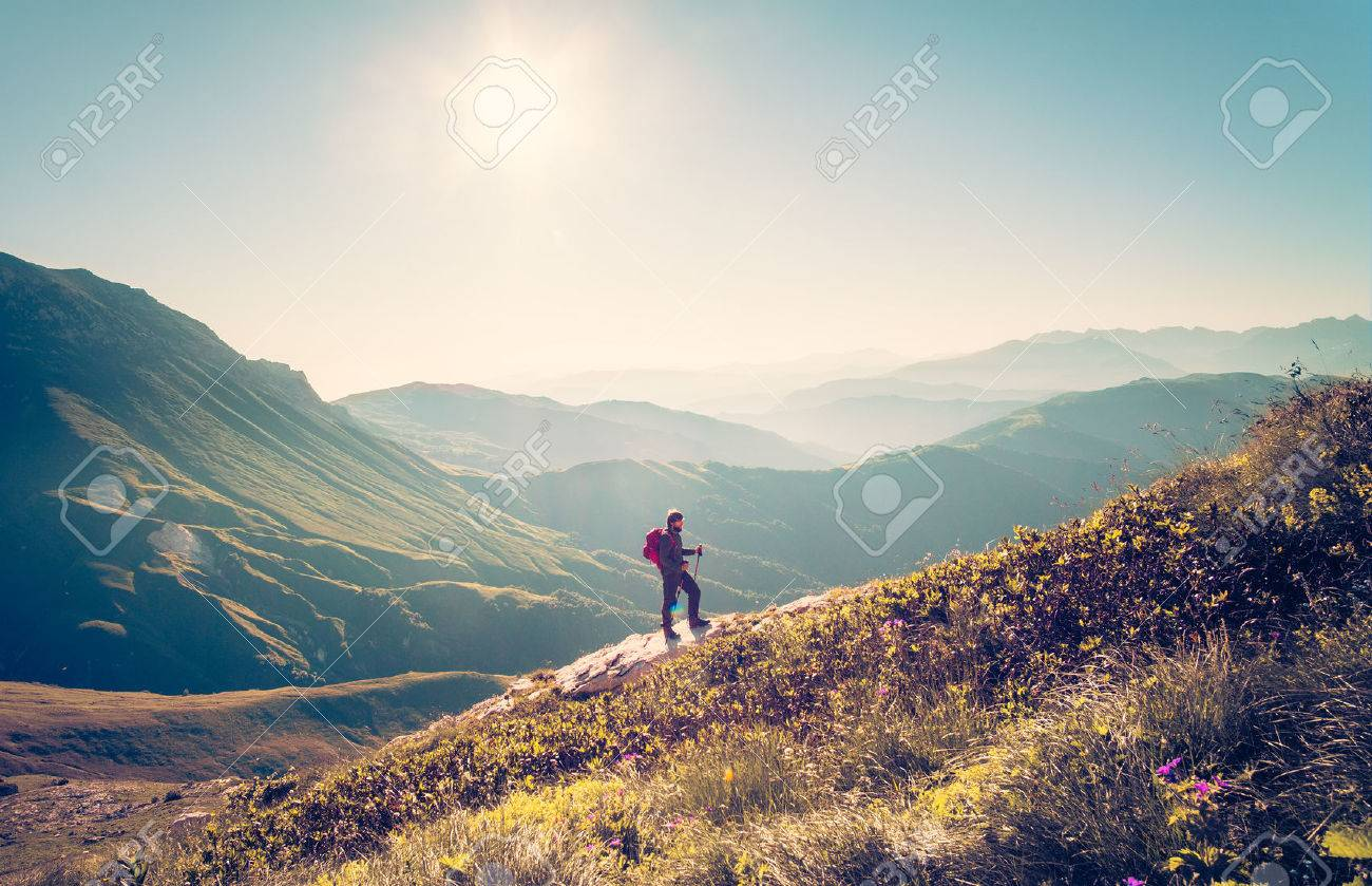 Man Traveler with backpack trekking Travel Lifestyle concept mountains on background Summer vacations activity outdoor aerial view Stock Photo - 55633462