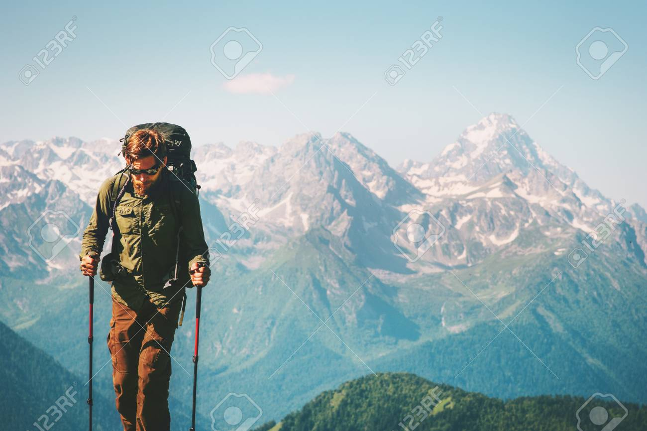 fe939d808411 Man Traveler at mountains hiking with backpack Travel Lifestyle concept  adventure outdoor rocky mountains landscape on
