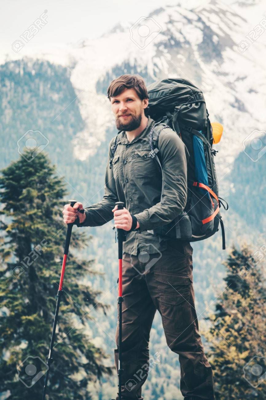 b91b6bcff90c Stock Photo - Traveler Man hiking with backpack Travel Lifestyle concept  adventure summer vacations outdoor forest mountains landscape on background