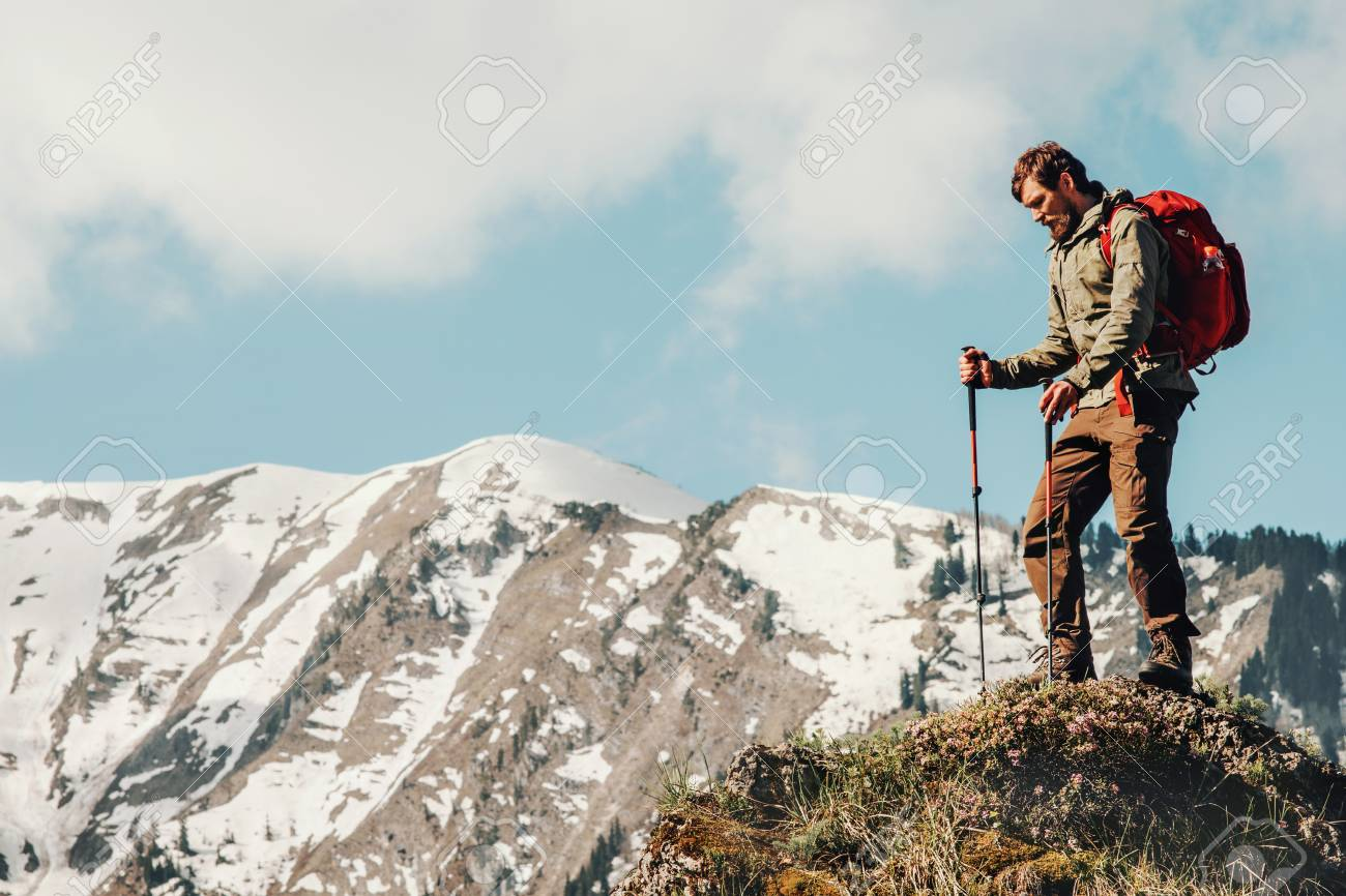 eebd96c0d688 Stock Photo - Traveler Man hiking with backpack Travel Lifestyle concept  adventure summer vacations outdoor snowy mountains landscape on background