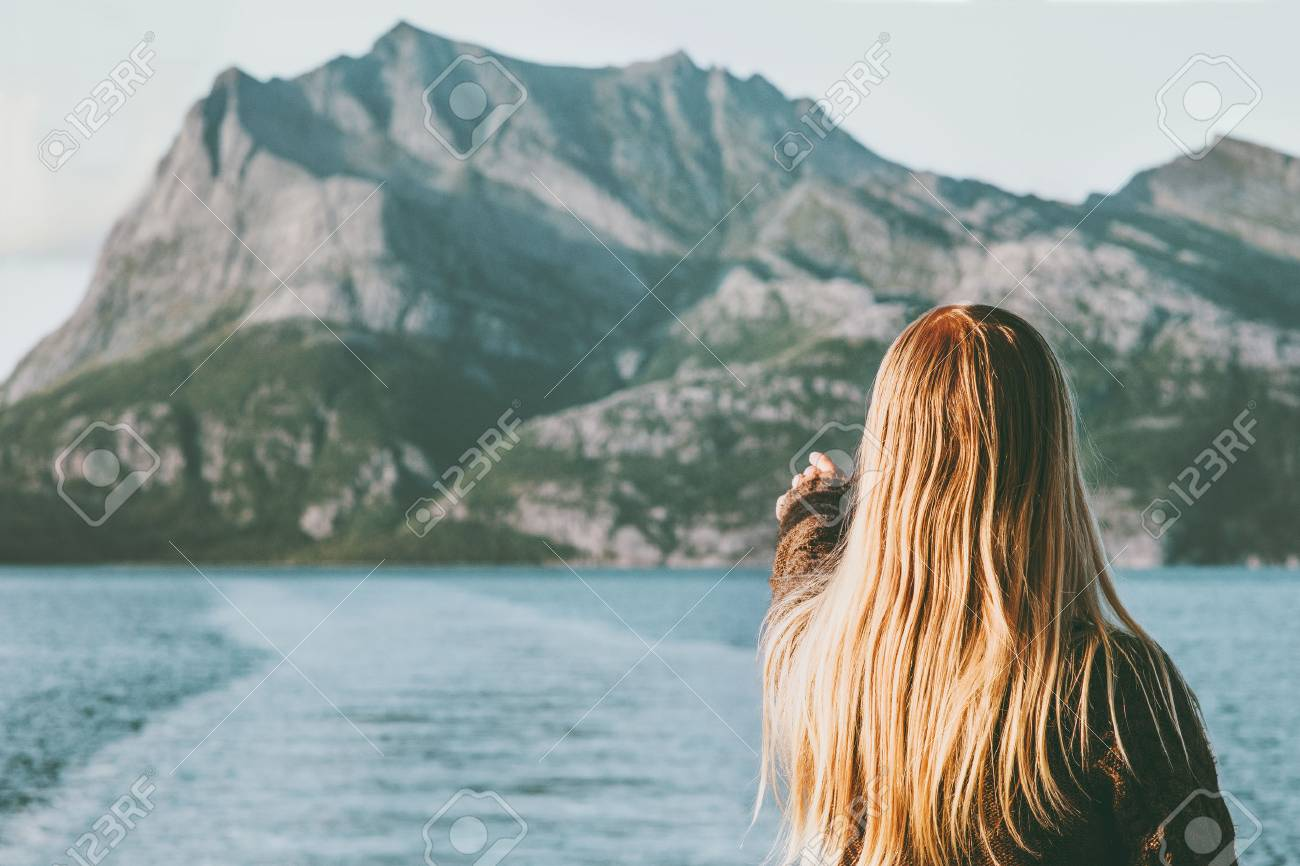 88595666-blonde-woman-traveling-by-ferry-enjoying-norway-mountains-and-sea-landscape-travel-lifestyle-concept.jpg