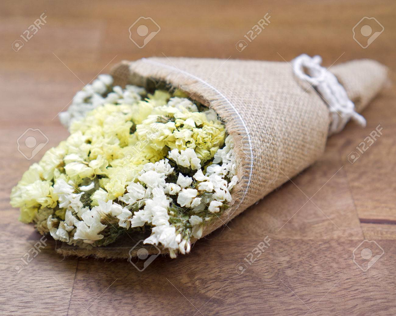 Dried Flower Bouquet On Wooden Table Stock Photo, Picture And ...