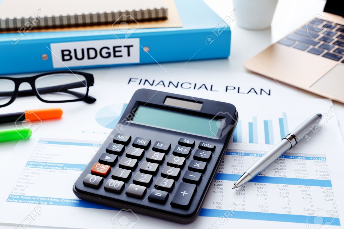 financial and budget planning concept with calculator laptop stock