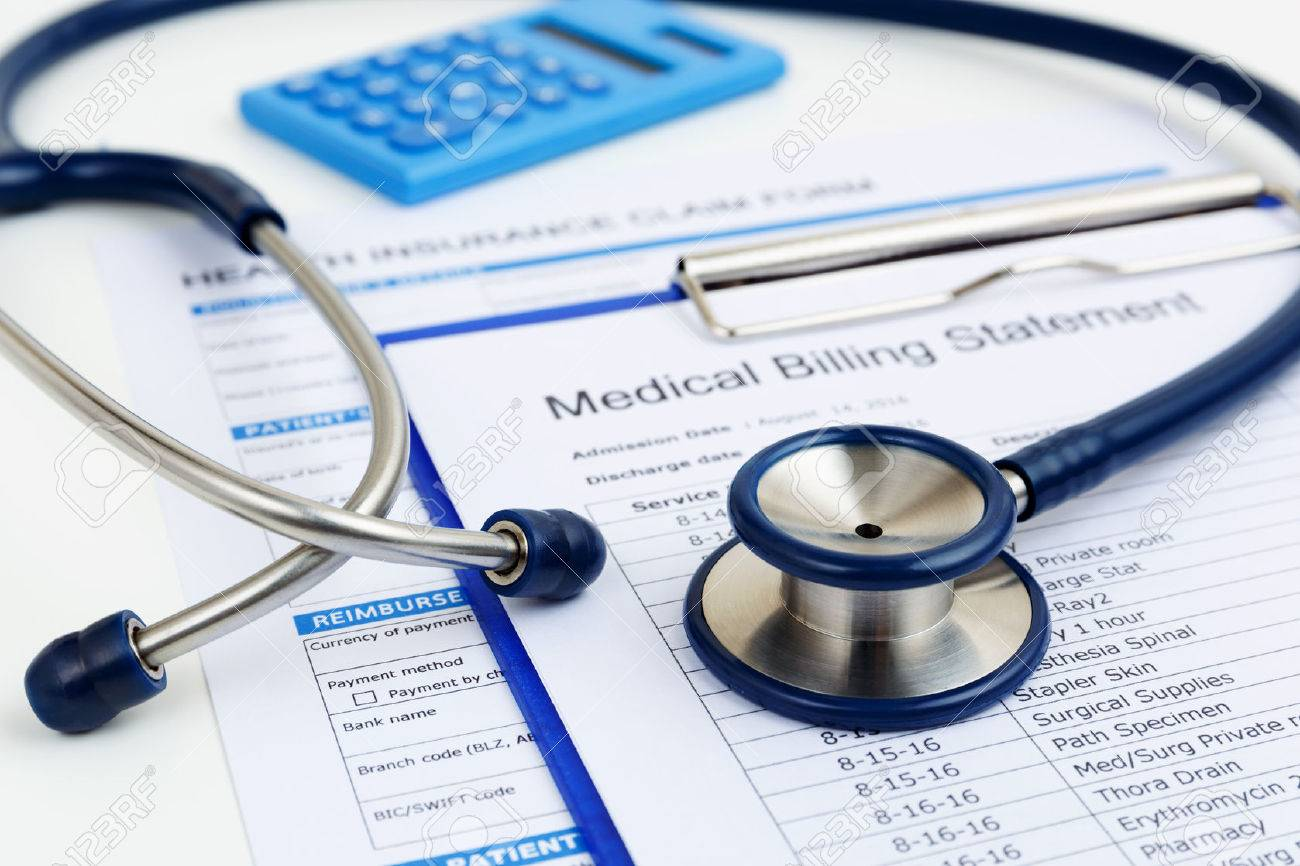 Stethoscope on medical bills and health insurance claim form - 64576030