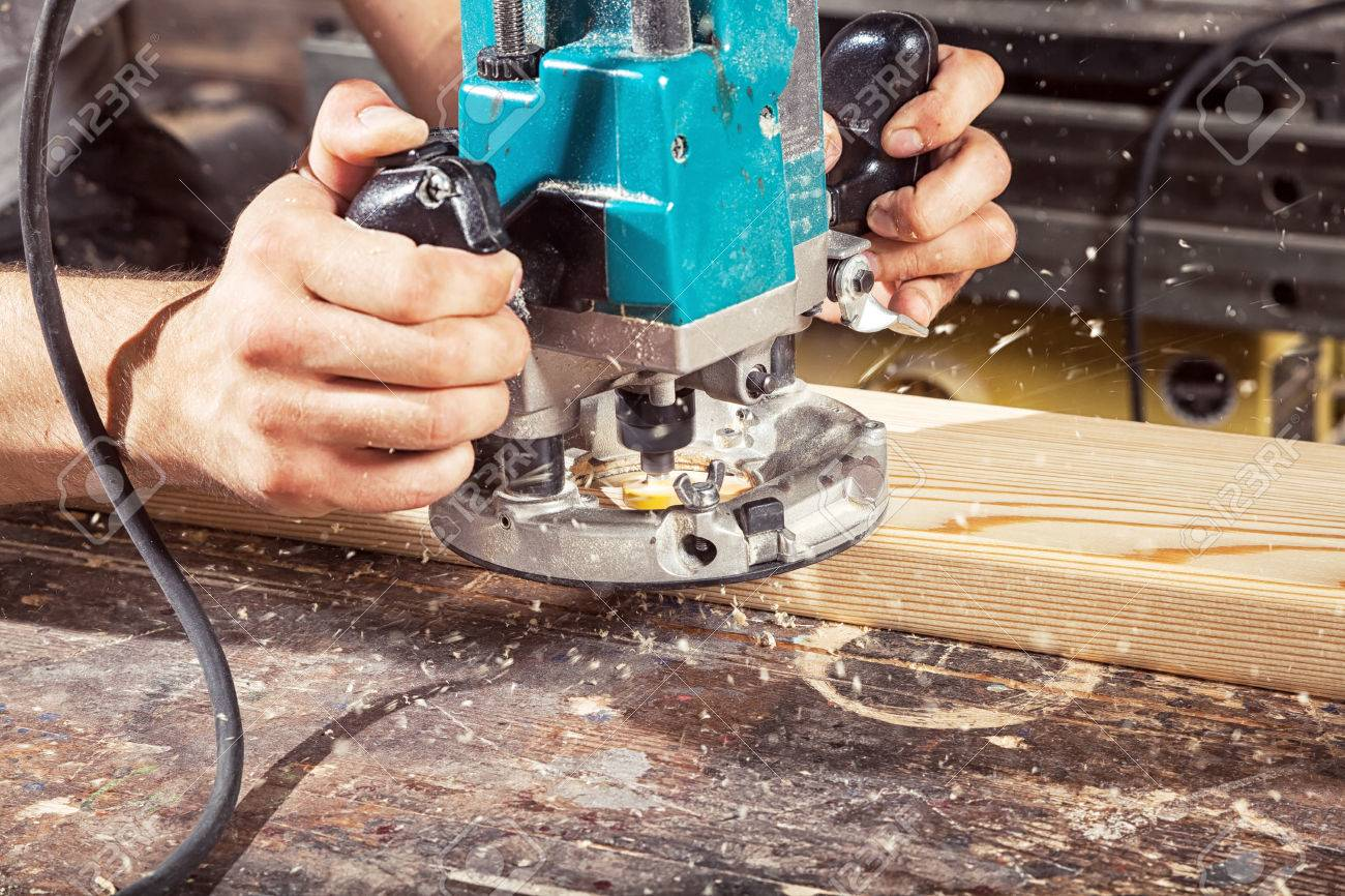 close-up of how a modern green milling machine works on wood,..