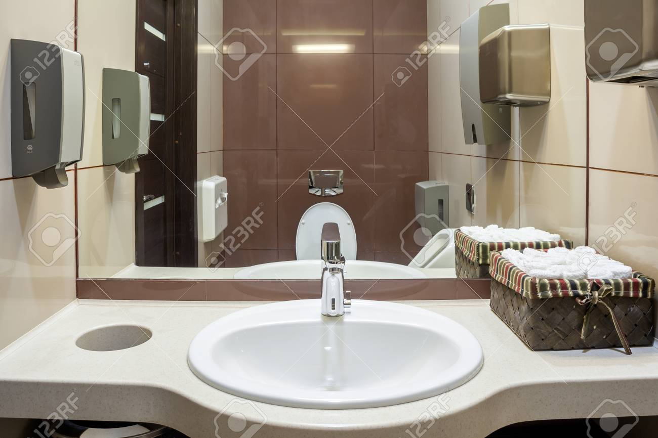 Large White Sink In Public Toilet With Paper Towels, Automatic Hand Dryer,  Dry Sink