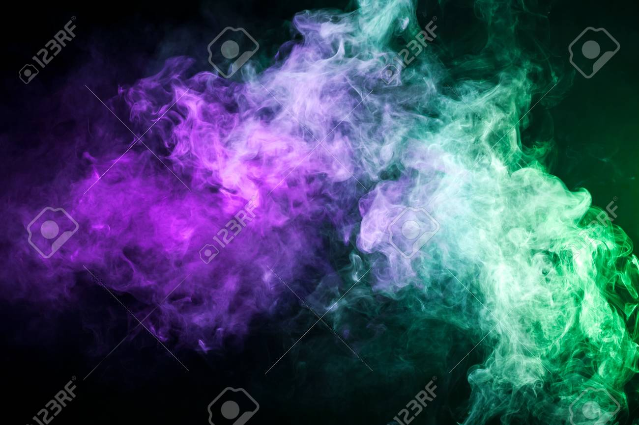 Thick Colorful Smoke Of Purple And Green On A Black Isolated Stock Photo Picture And Royalty Free Image Image 96362344