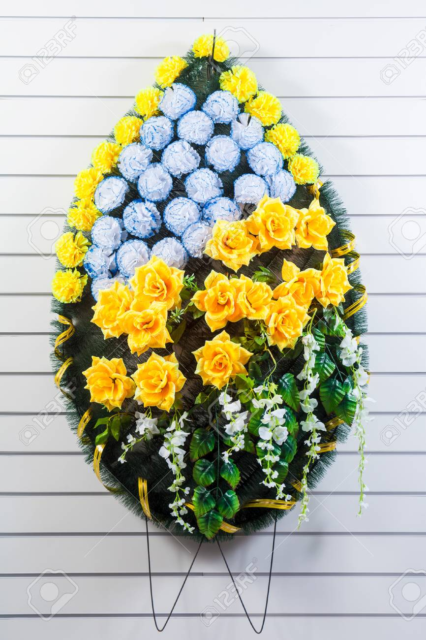 Luxury Funeral Wreath With Blue And Yellow Flowers On A White Stock Photo Picture And Royalty Free Image Image 107916410