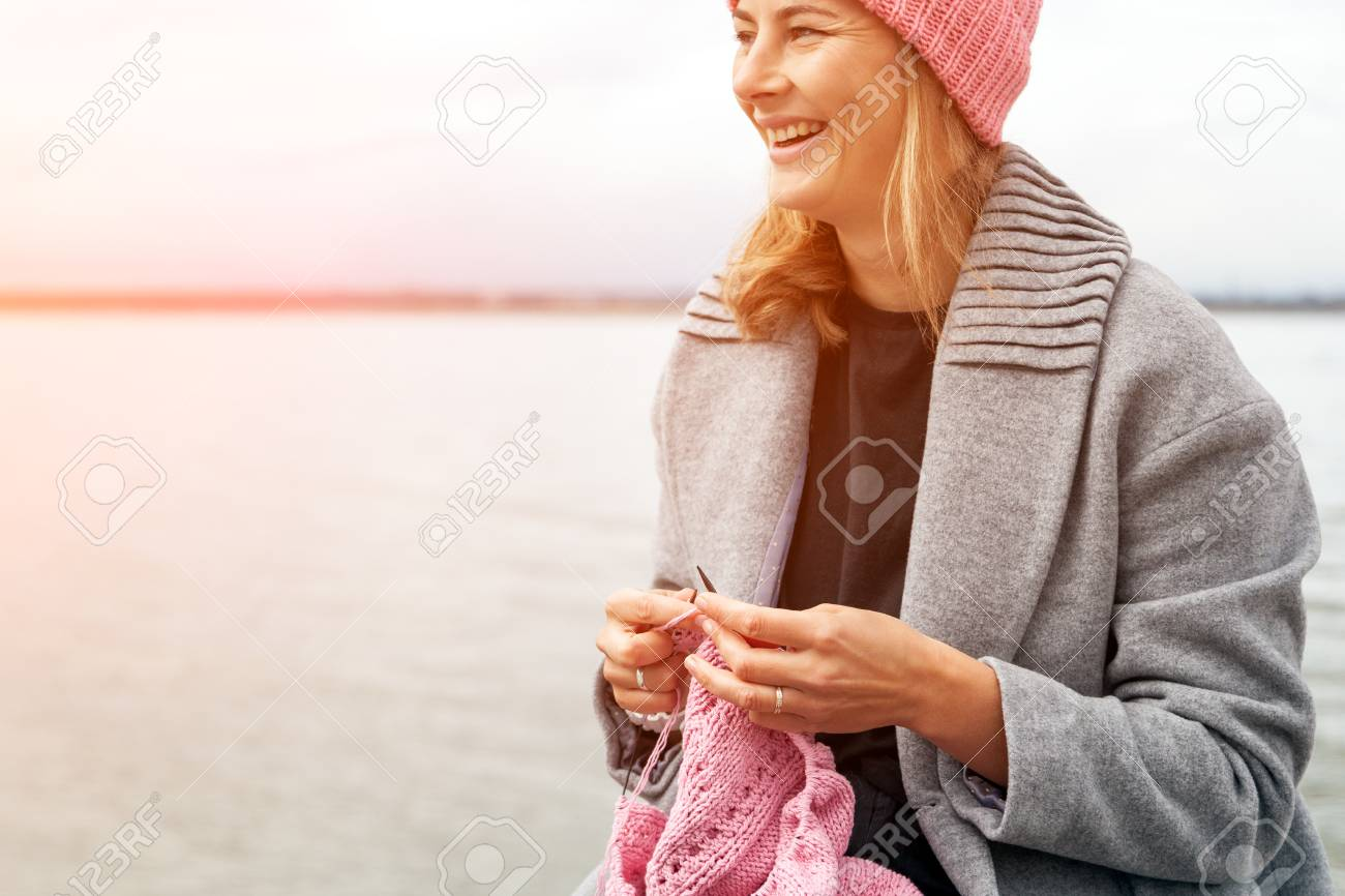 Close Up Og A Young Married Woman Dressed In Trendy Coat Knitting