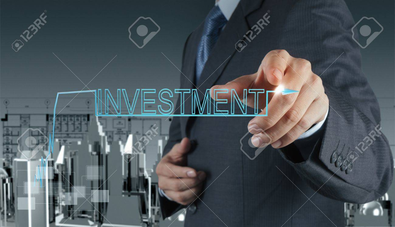businessman hand pointing to investment concept Stock Photo - 16695307