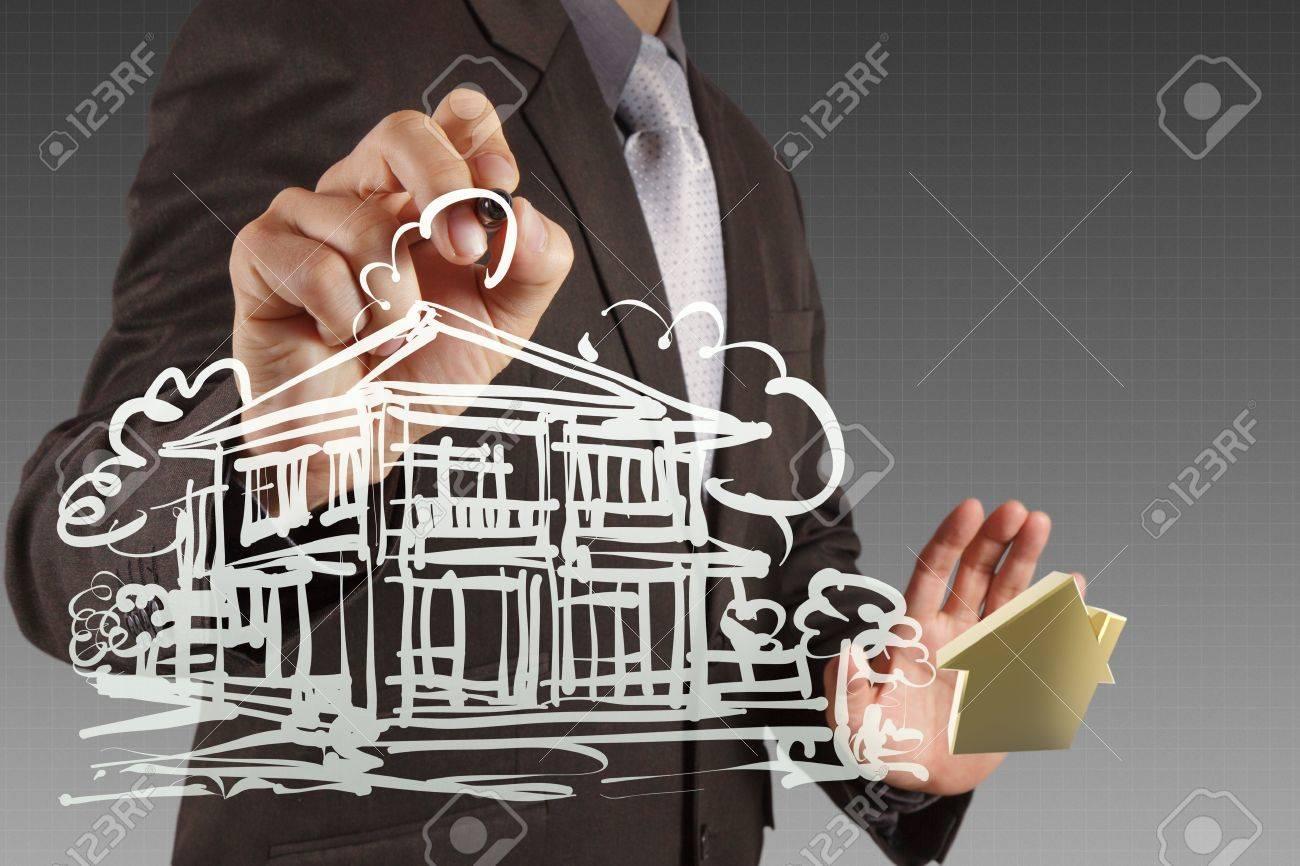 businessman draws building development concept Stock Photo - 16707247