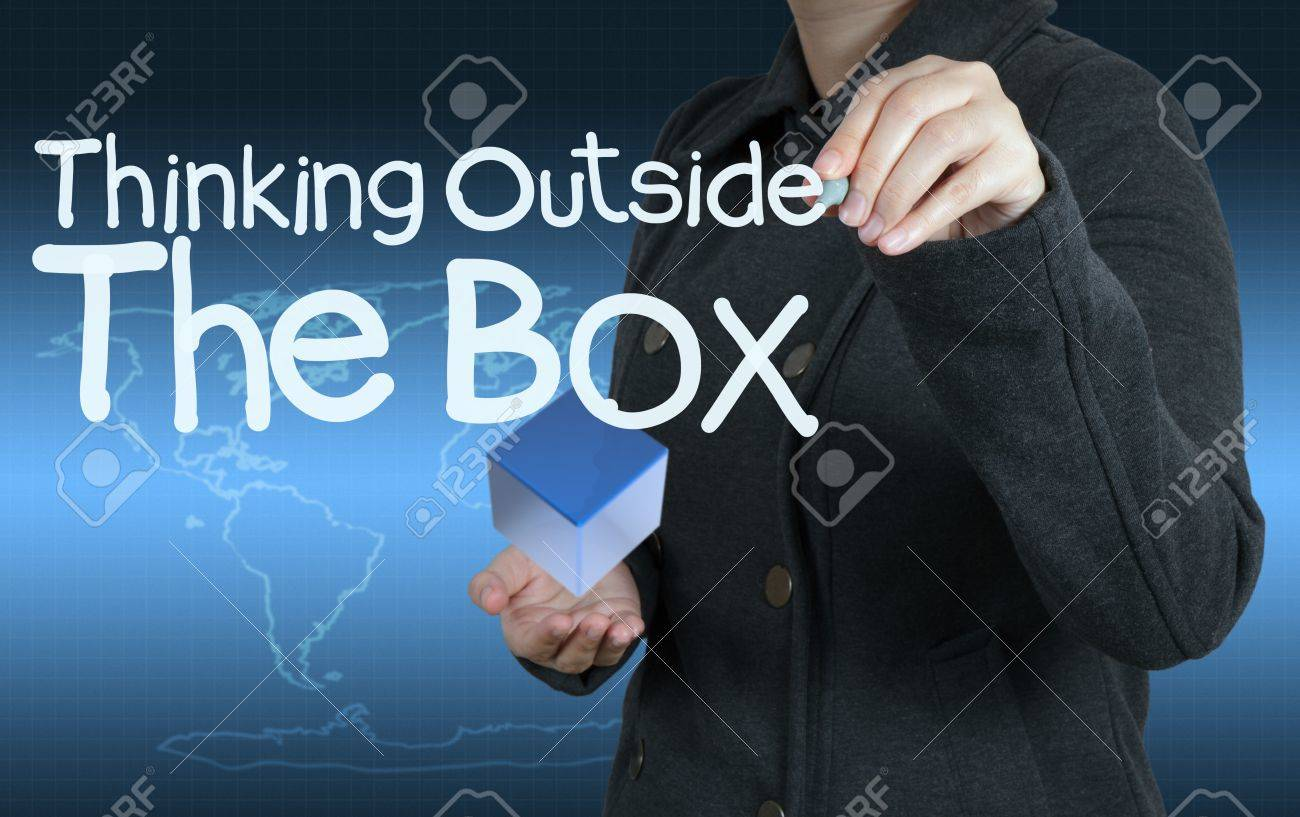 businesswoman hand draws word thinking outside the box as concept Stock Photo - 16713249