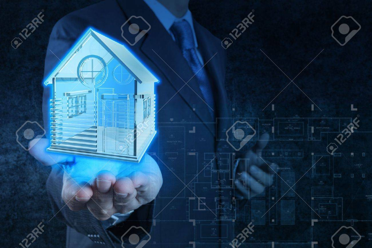 businessman hand shows house model as concept Stock Photo - 18237611