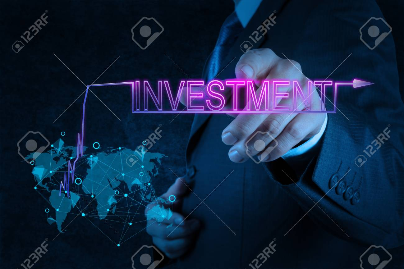 businessman hand pointing to investment as concept Stock Photo - 18237512