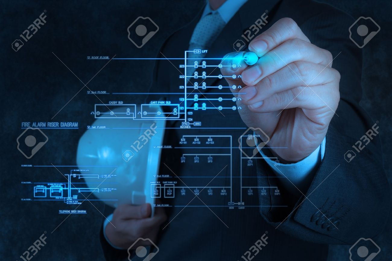 Engineer Draws An Electronic Single Line And Fire Alarm Riser Circuit Diagram For Schematic Stock Photo 18237502