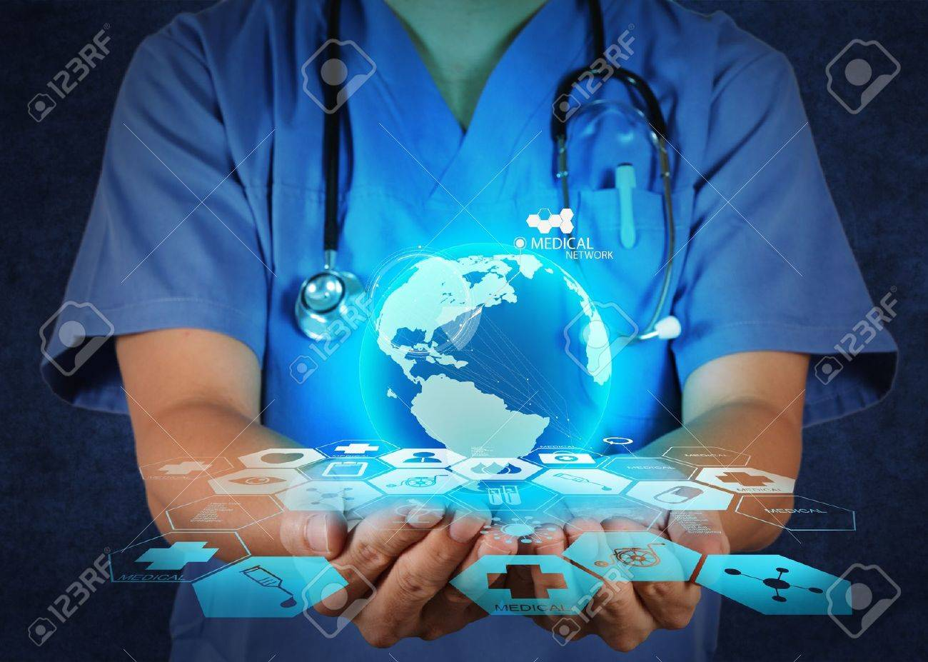 Medical Doctor holding a world globe in her hands as medical network concept Stock Photo - 19646822