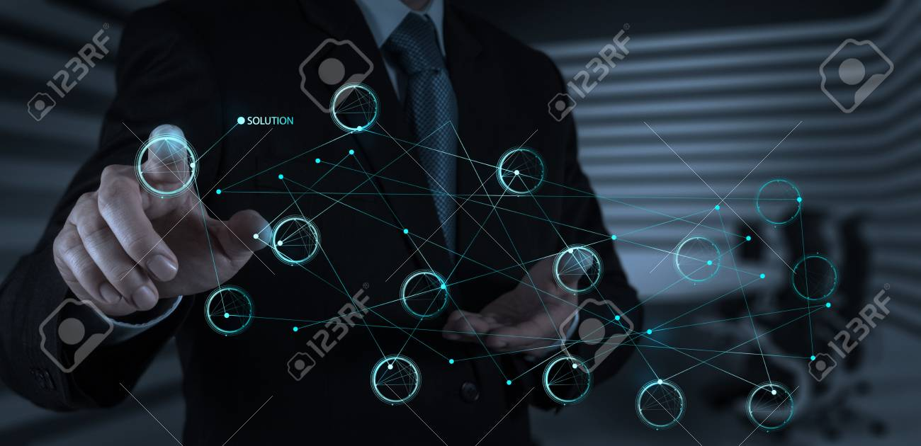 businessman hand pushing solution diagram on a touch screen interface as concept Stock Photo - 20101219