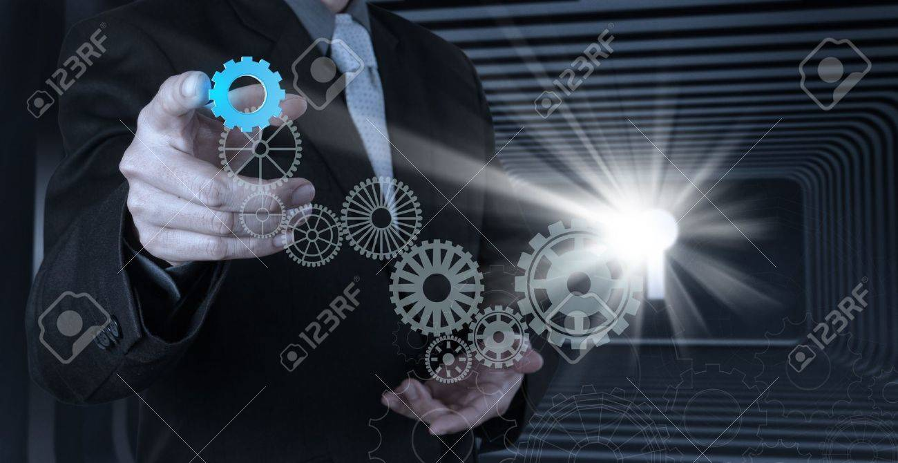 businessman hand draws gear to success concept Stock Photo - 20101161