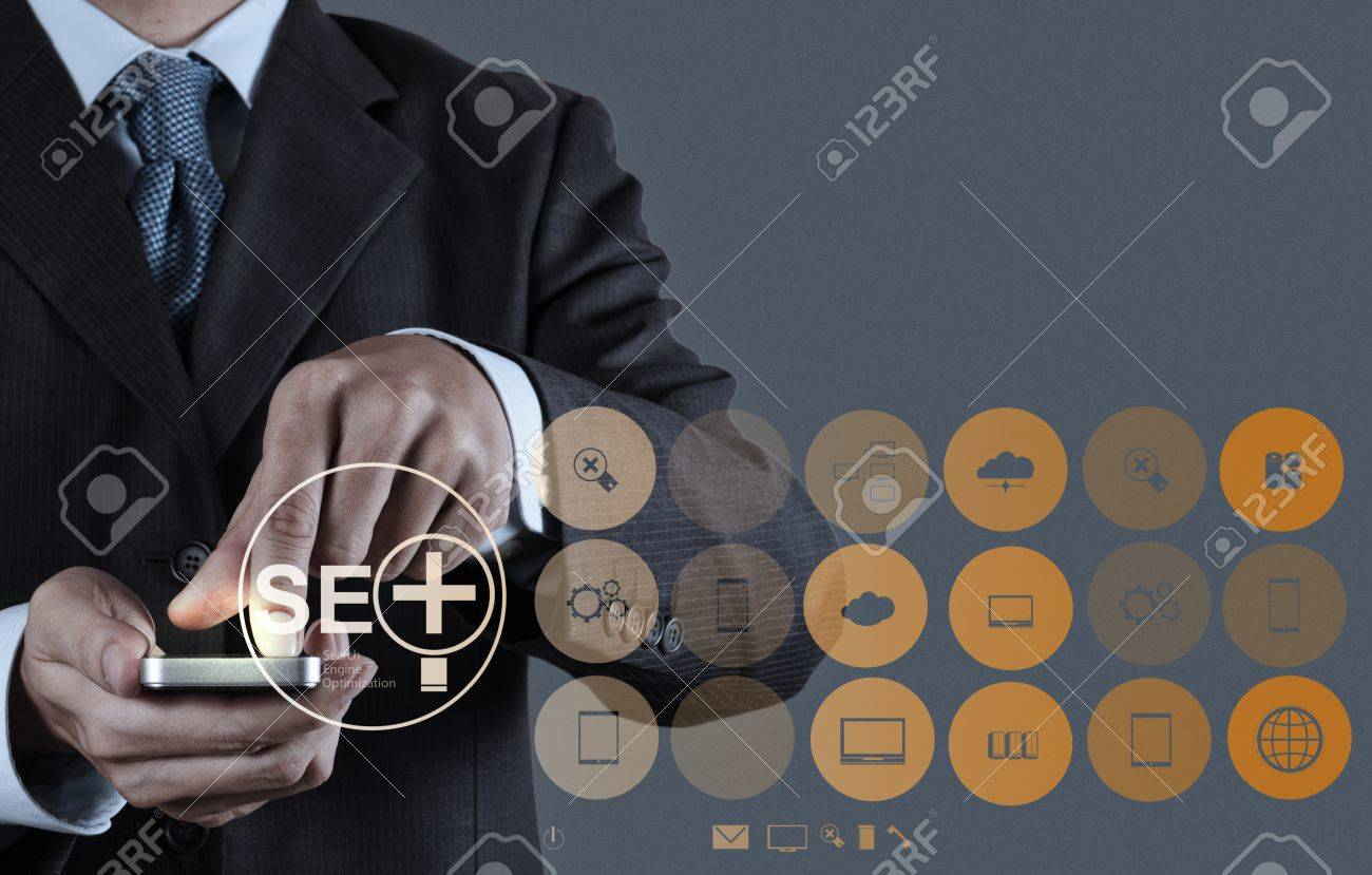 businessman hand showing search engine optimization SEO as concept Stock Photo - 20643979
