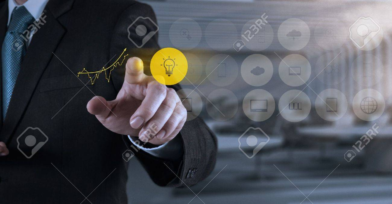 businessman hand working with new modern computer and business strategy as concept Stock Photo - 21271179