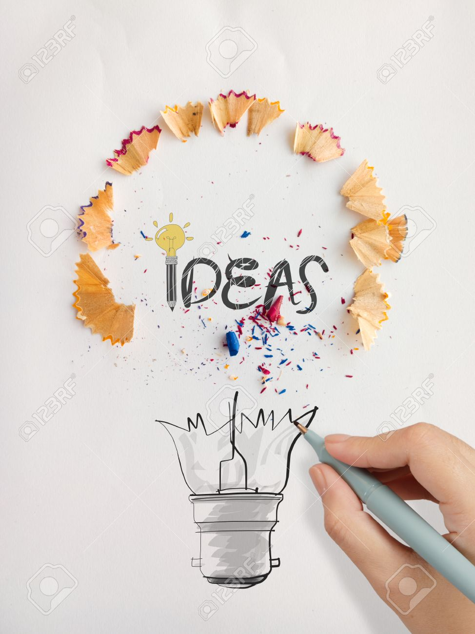 hand drawn light bulb word design idea with pencil saw dust on paper as creative concept - Design Idea