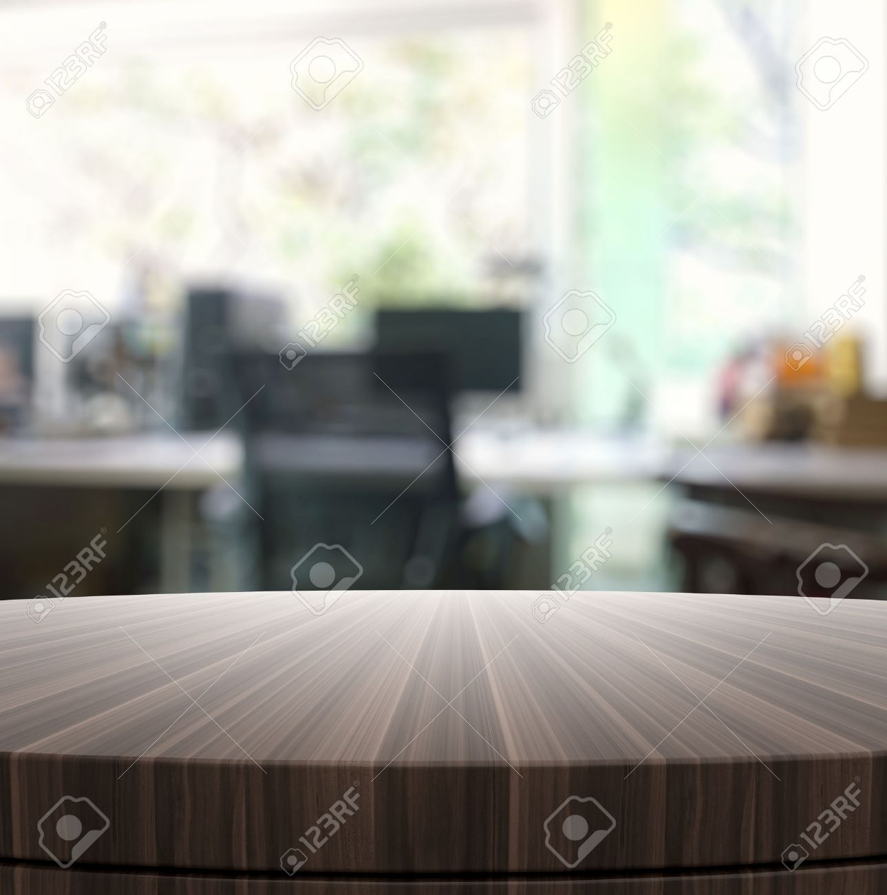 Empty wood table and blurred living room background stock photo - Empty Wooden Round Table And Blurred Background For Product Presentation Stock Photo 35589433