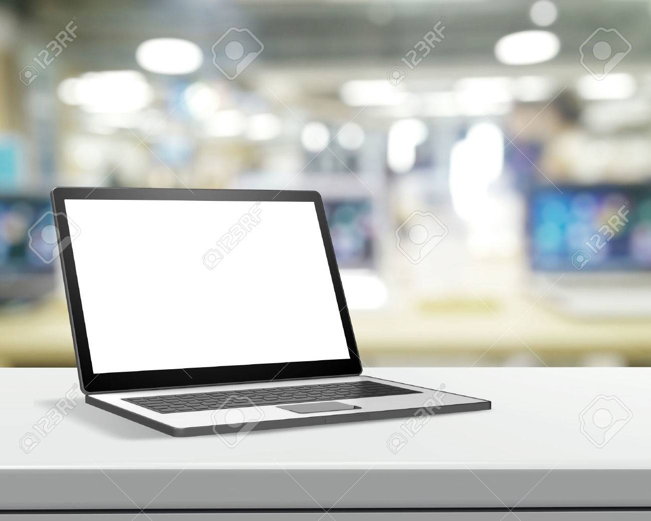 3d Laptop with blank screen on laminate table and blurred background Standard-Bild - 37015418