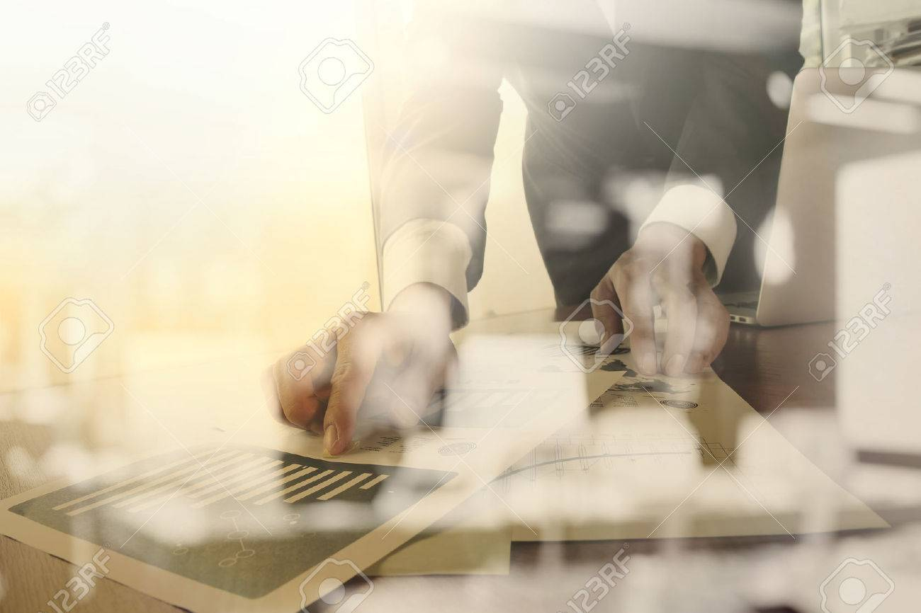 business documents on office table with smart phone and digital tablet and graph business diagram and man working in the background Stock Photo - 43290637