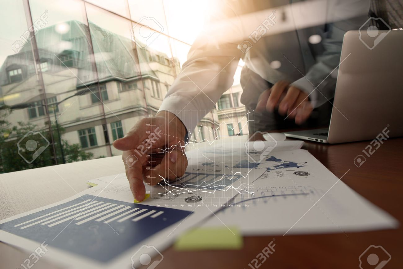 Double exposure of business man hand working on blank screen laptop computer on wooden desk as concept Stock Photo - 44710889
