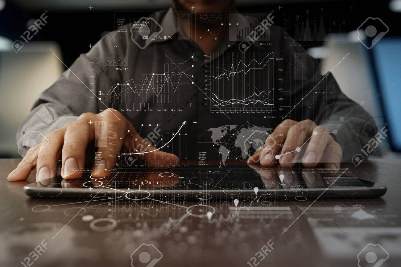 business man hand working on laptop computer with digital layer business strategy and social media diagram on wooden desk Stock Photo - 50065742