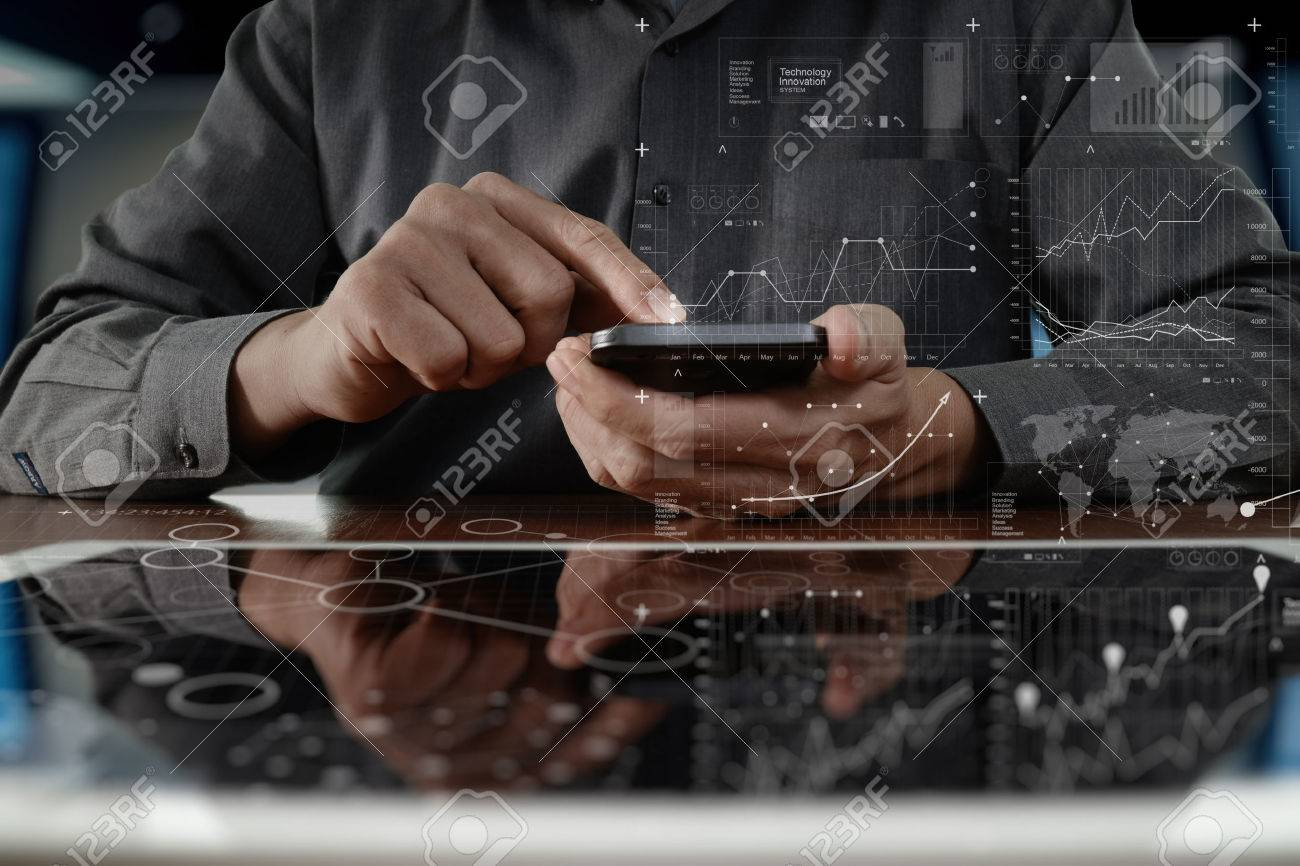 business man hand working on digital tablet computer and smartphone with digital layer business strategy and social media diagram on wooden desk - 50066085
