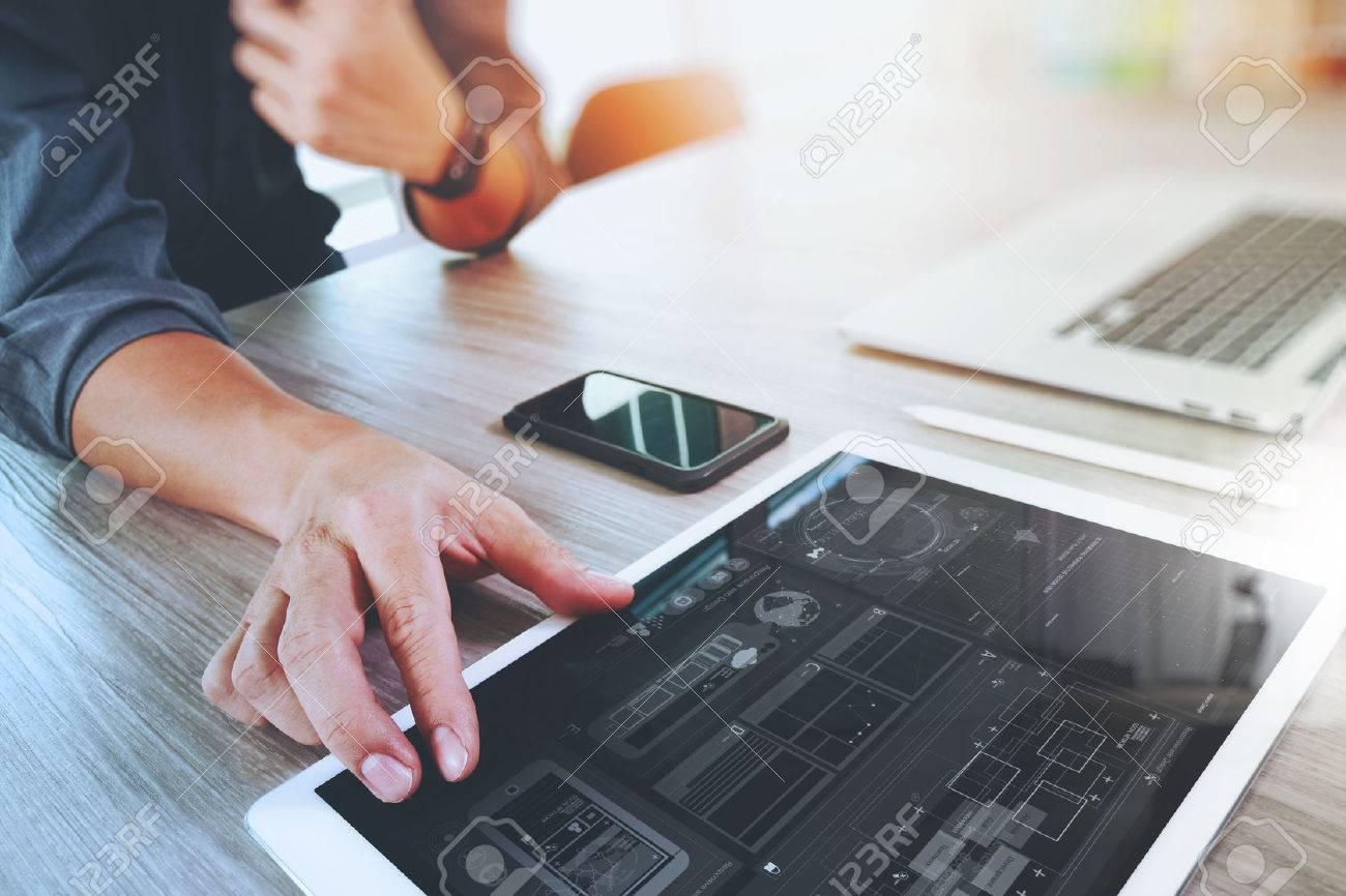 Website designer working digital tablet and computer laptop with smart phone and digital design diagram on wooden desk as concept - 51494844