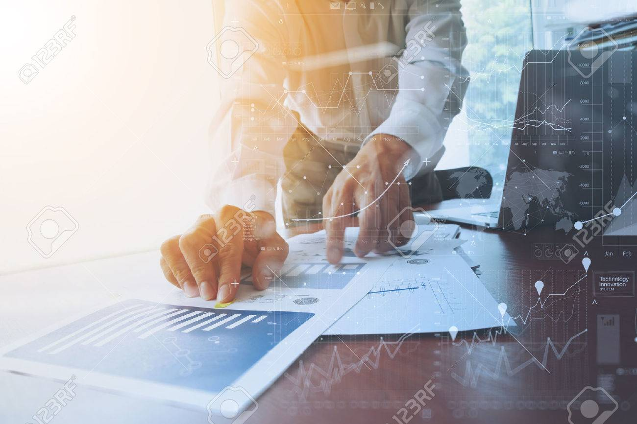 business documents on office table with smart phone and digital tablet and graph business with social network diagram and man working in the background Banque d'images - 51495797