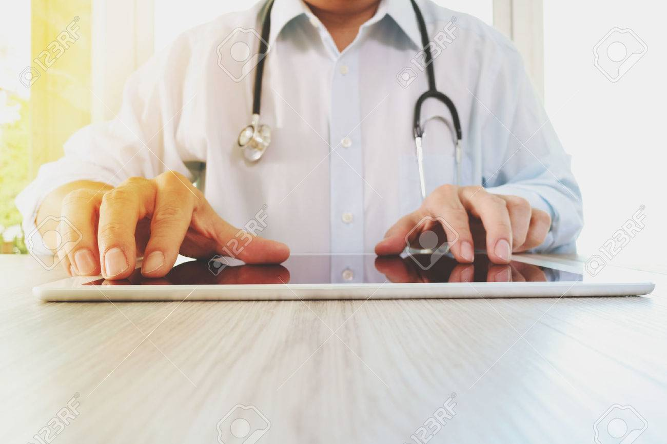 Medicine doctor hand working with modern digital tablet pad as medical network concept Standard-Bild - 51496621
