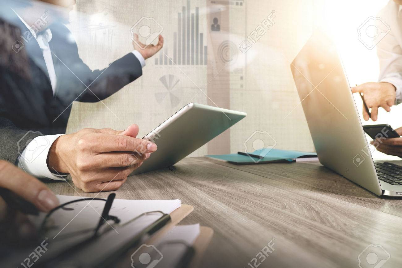 Businessman making presentation with his colleagues and business strategy digital layer effect at the office as concept Standard-Bild - 53603399
