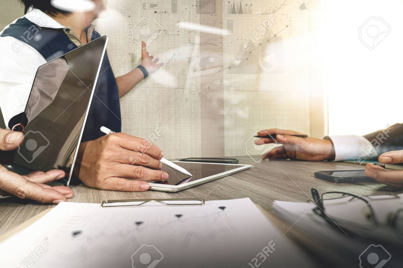 Businessman making presentation with his colleagues and business strategy digital layer effect at the office as concept Standard-Bild - 53603742