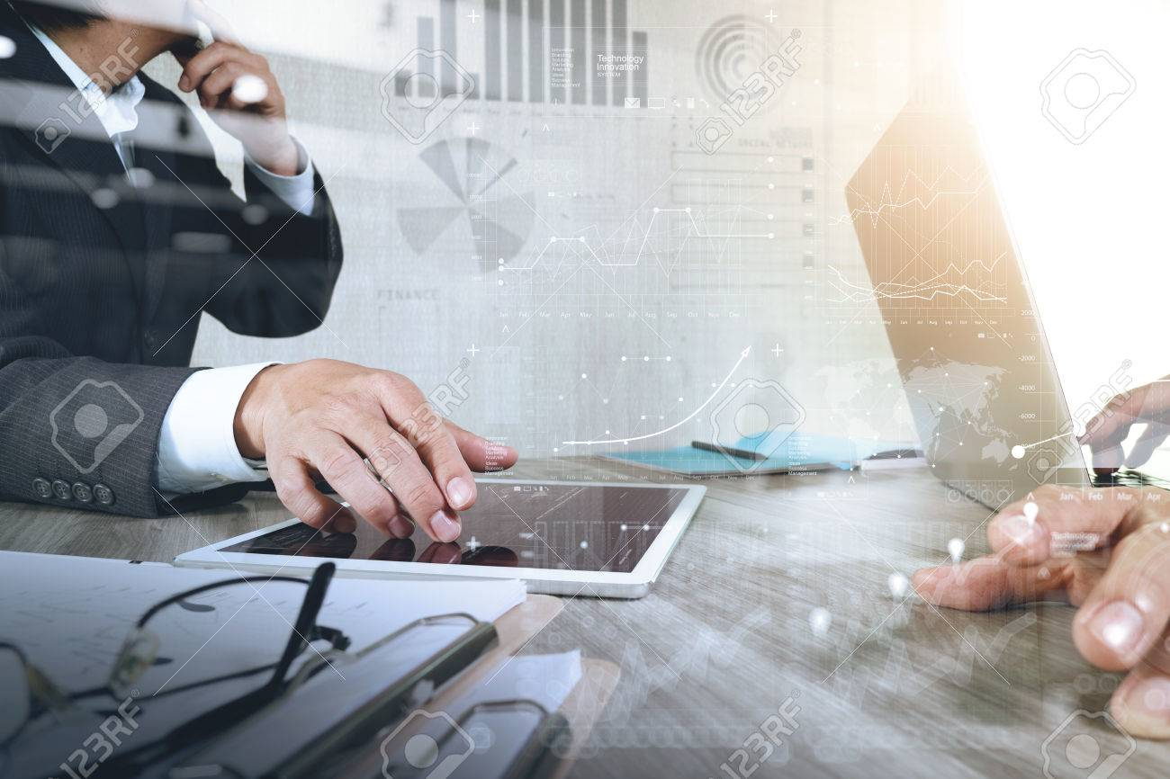Businessman making presentation with his colleagues and business strategy digital layer effect at the office as concept Standard-Bild - 53604538