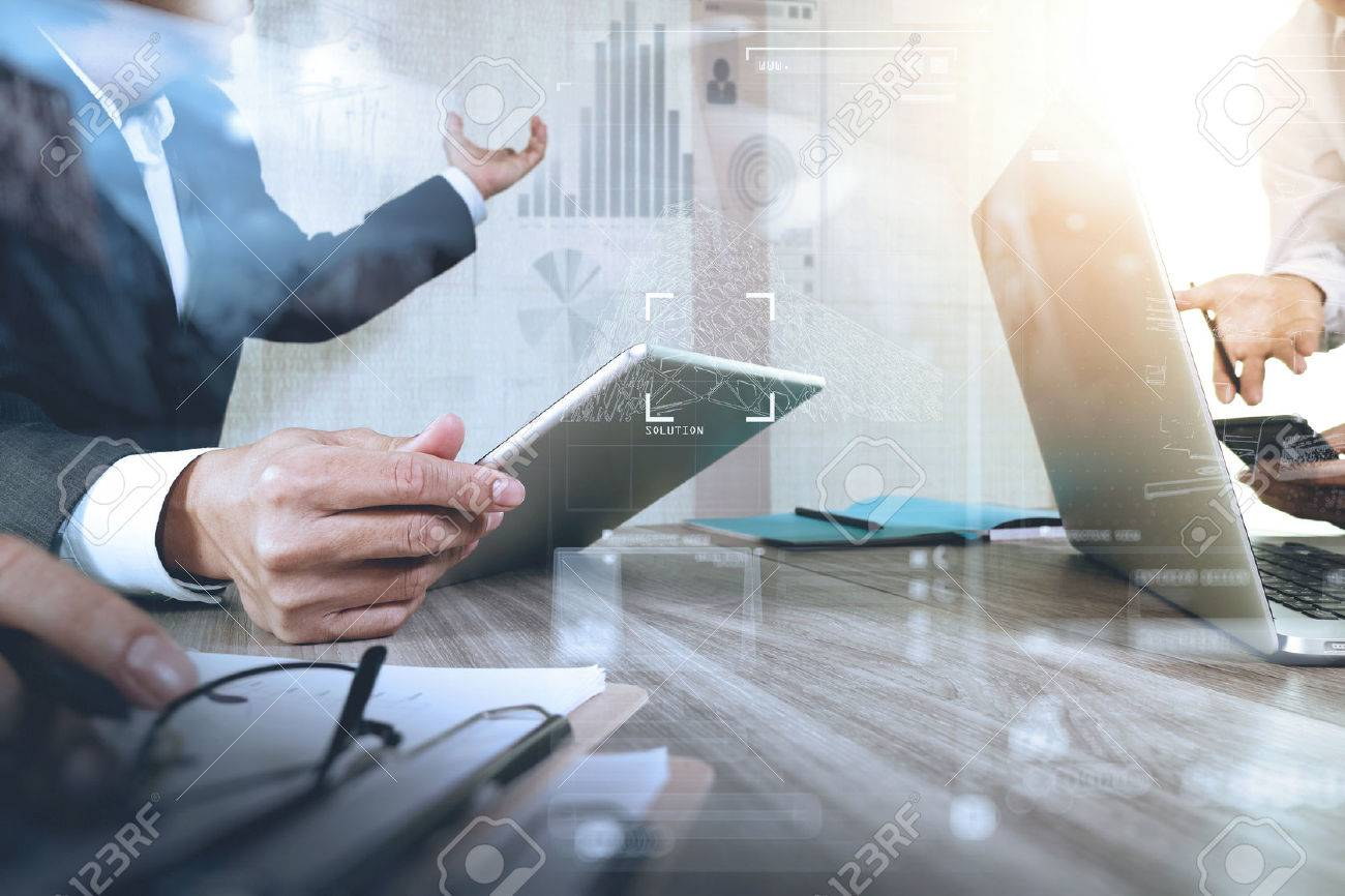 Businessman making presentation with his colleagues and business strategy digital layer effect at the office as concept Standard-Bild - 53604799