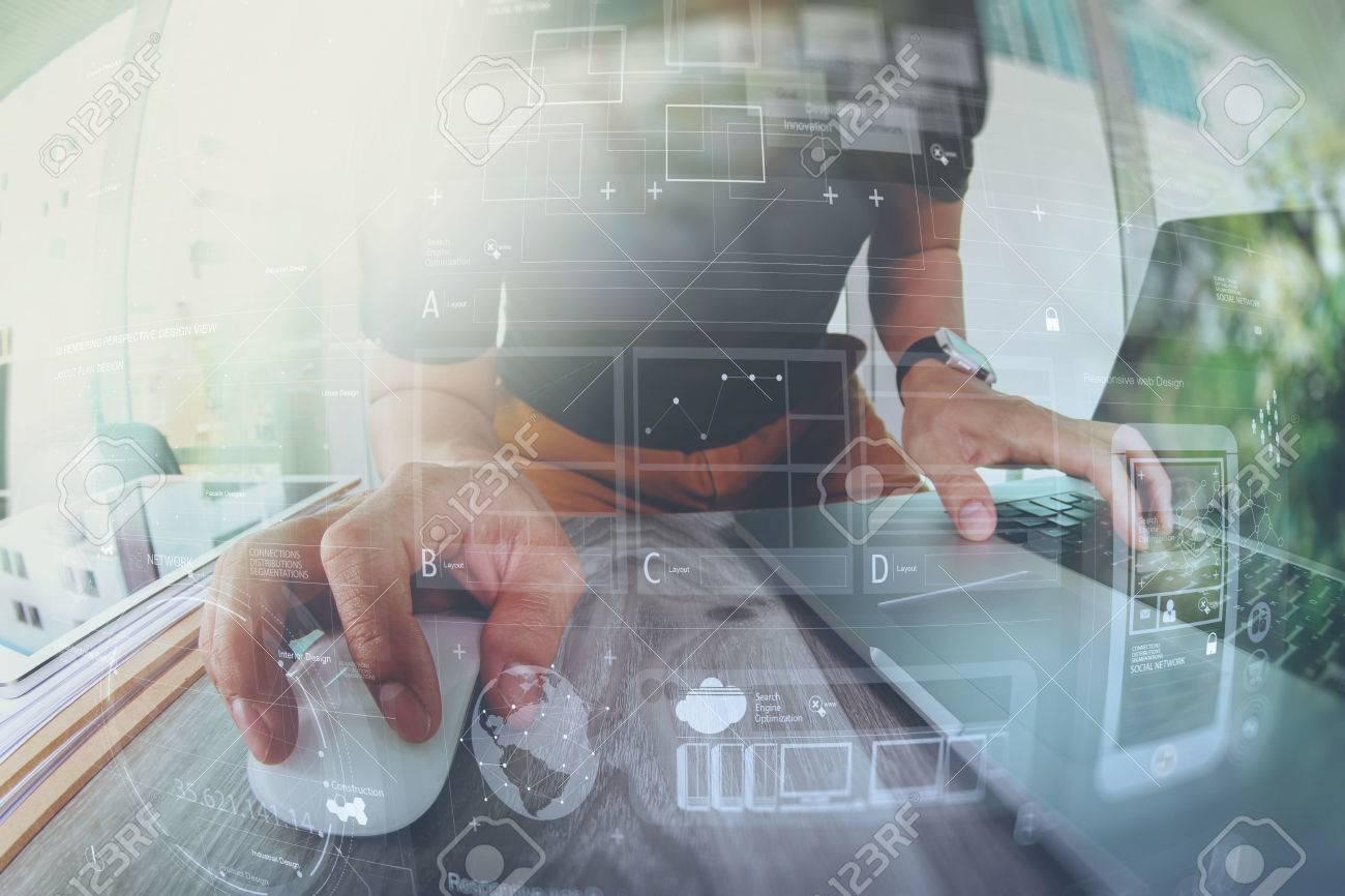 Designer hand working with laptop computer on wooden desk as responsive web design concept Standard-Bild - 53607326