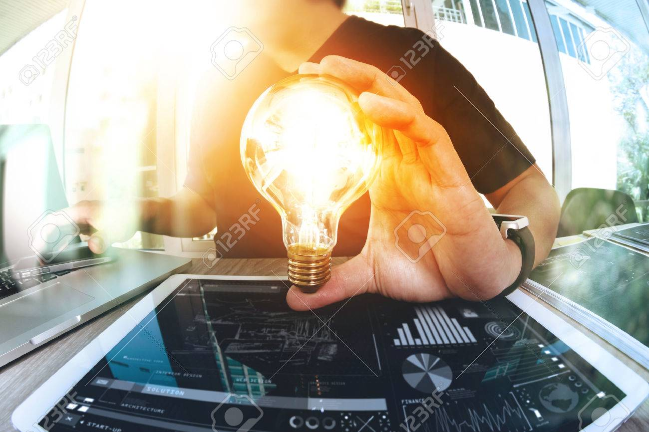 designer hand showing creative business strategy with light bulb as concept Standard-Bild - 53607638