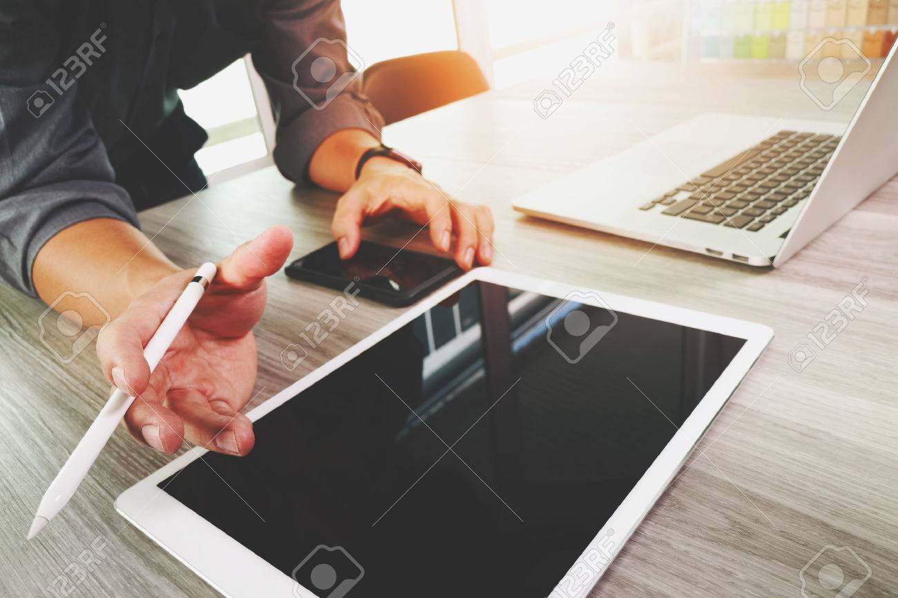 Website designer working blank screen digital tablet and computer laptop with smart phone on wooden desk as concept Standard-Bild - 53608178