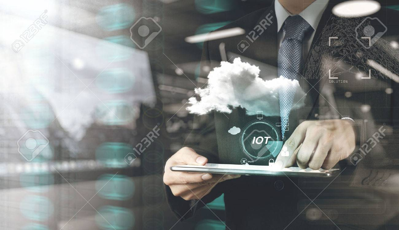 double exposure of hand showing Internet of things (IoT) word diagram as concept Standard-Bild - 53608694