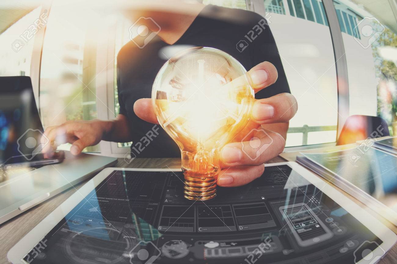 designer hand showing creative business strategy with light bulb as concept - 55731144