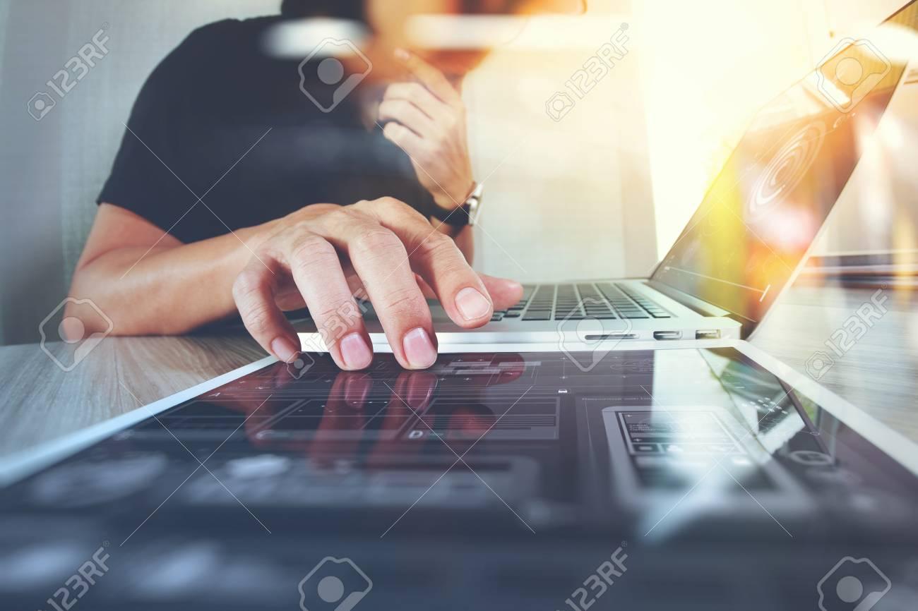 Website designer working digital tablet and computer laptop and digital design diagram on wooden desk as concept - 55730633