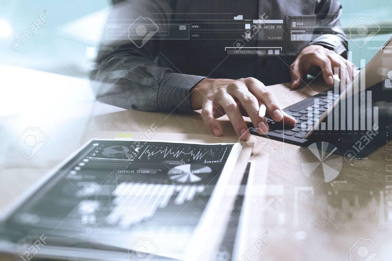 Businessman hand working concept. Documents finance graphic chart. Digital tablet keyboard dock screen computer design smart phone using. Eyeglass on marble desk. Sun flare effect - 62689445