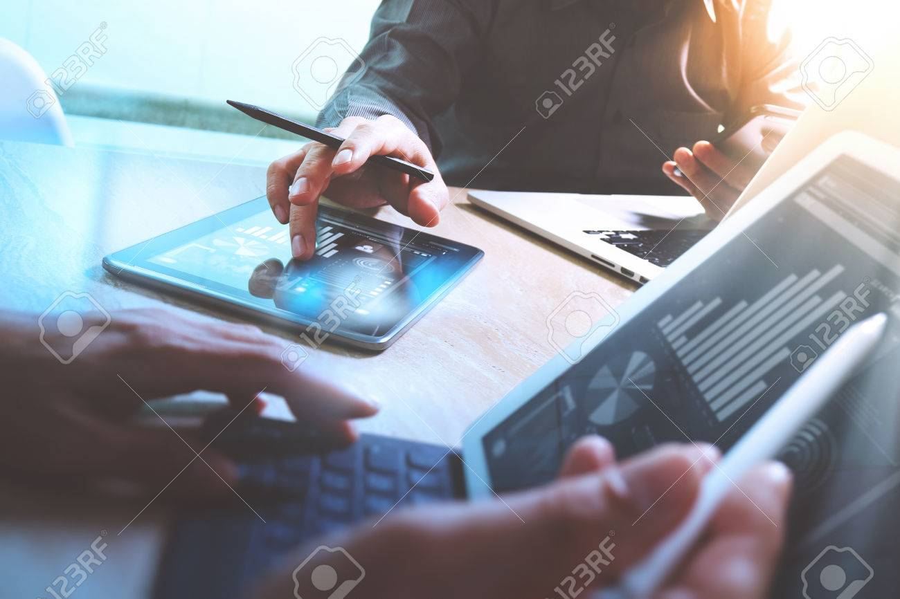 Business team meeting present. Photo professional investor working with new startup project. Finance managers meeting.Digital tablet laptop computer design smart phone using, keyboard docking screen foreground - 64118427