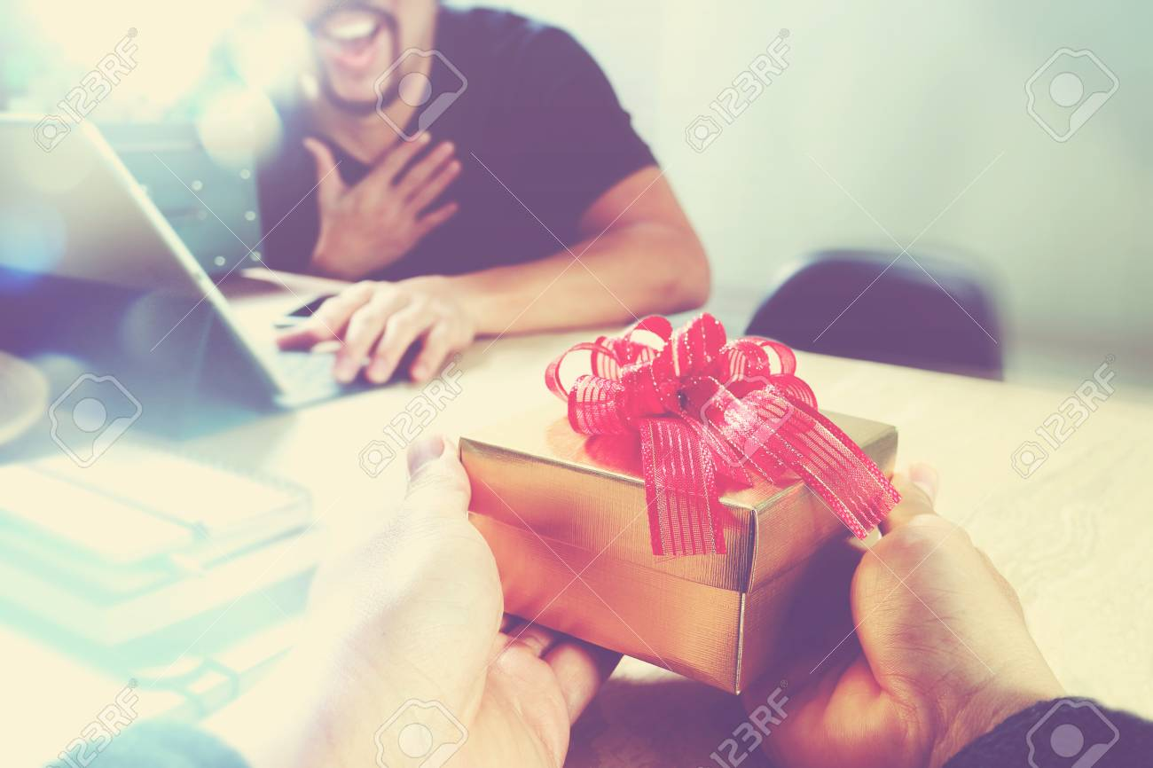 Gift Giving.business Creative Designer Hand Giving His Colleague ...